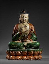 A MONUMENTAL SANCAI FIGURE OF BUDDHA SHAKYAMUNI, MING