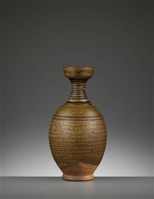 A BROWN-GLAZED STONEWARE BOTTLE VASE, SUI-TANG DYNASTY