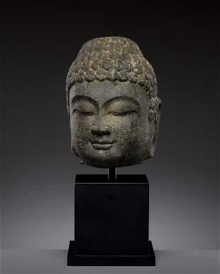 A DARK GRAY STONE HEAD OF BUDDHA, NORTHERN QI - TANG