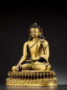 A LARGE COPPER-ALLOY CROWNED BUDDHA, MALLA, 14TH - 15TH