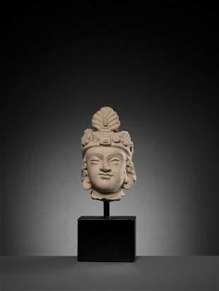 A TERRACOTTA HEAD OF MAITREYA, 3RD-5TH CENTURY