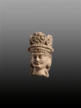 A TERRACOTTA HEAD OF A BODHISATTVA, 3RD-5TH CENTURY