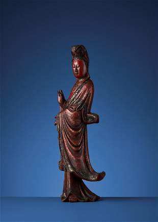 A VIETNAMESE RED AND GILT-LACQUERED WOOD GUANYIN