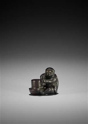OKATOMO: A RARE SHITAN WOOD NETSUKE OF A MONKEY
