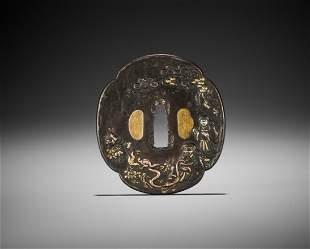 AN INLAID IRON TSUBA WITH CHINNAN SENNIN