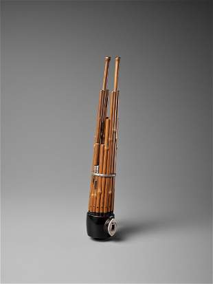 A BAMBOO AND LACQUER SHO (MOUTH ORGAN)