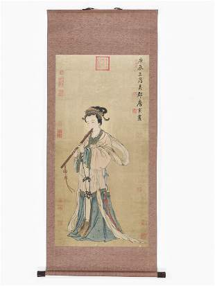 A SCROLL PAINTING OF A LADY PLAYING A FLUTE