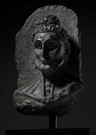 A SCHIST HEAD OF THE EMACIATED BUDDHA, GANDHARA