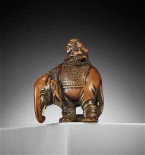 MASAYUKI: A WOOD NETSUKE OF A MAN AND ELEPHANT