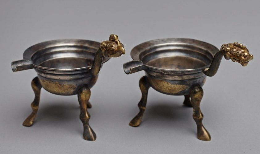 TWO TRIPOD VESSELS WITH HANDLE AND SPOUT