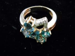 14K Gold Ring with Blue Topaz and Diamonds