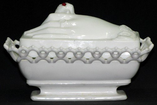 10: A Milk Glass Hand on Nest Covered Box