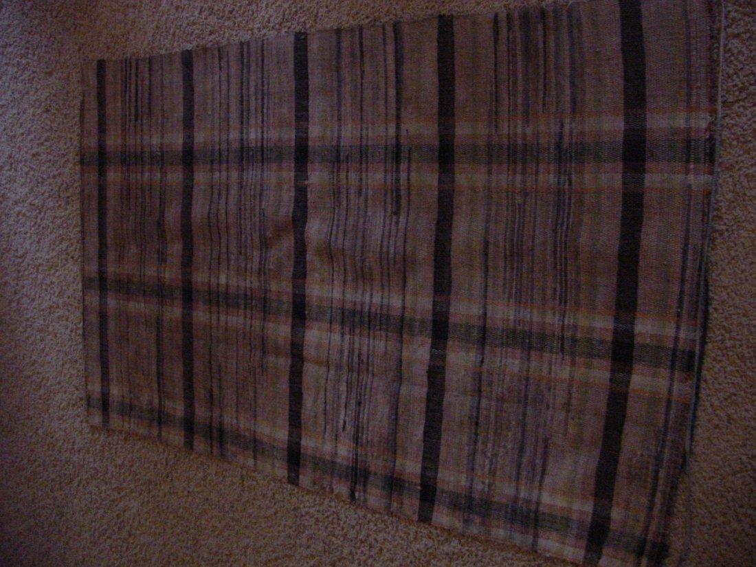 A Hand Woven Rag Rug