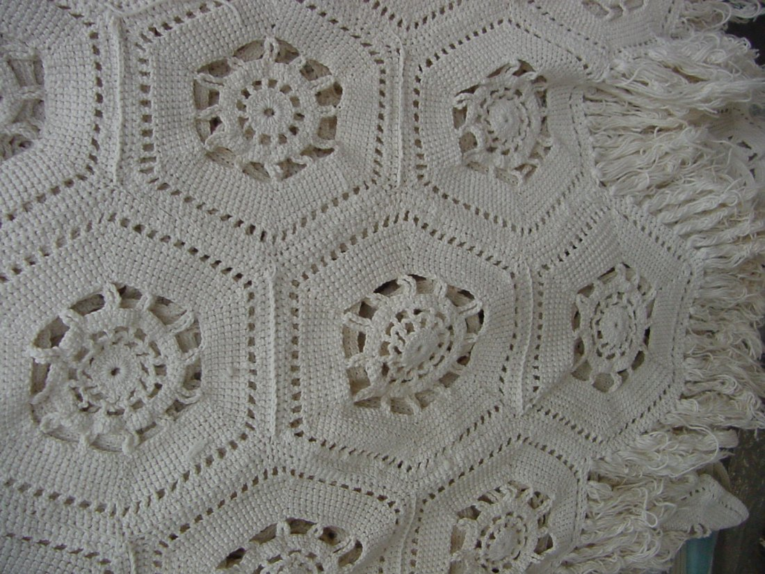 12: A Hand Crocheted Tablecloth/Bedspread