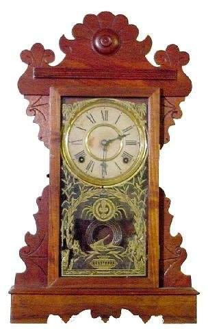 E. N. Welch Walnut Kitchen Clock, 8 Day Half Hour