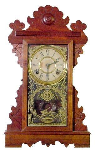 1013: E. N. Welch Walnut Kitchen Clock, 8 Day Half Hour