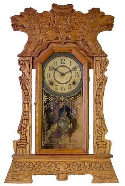 11: Ingraham Oak Kitchen Clock w/Lions Heads, Ca. 1900