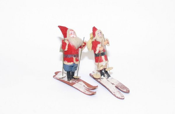 1004: (2) Chalk Faced Santas on Skis