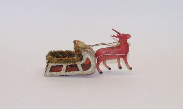 1009: Chalk Faced Santa in Cardboard Sleigh