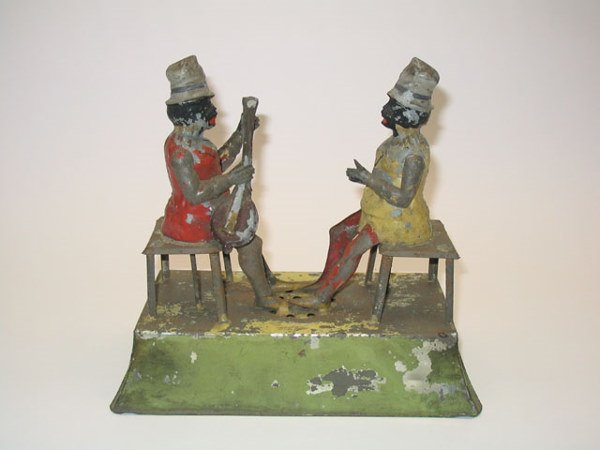 2008: Early Tin Black Dueling Banjo Players Toy