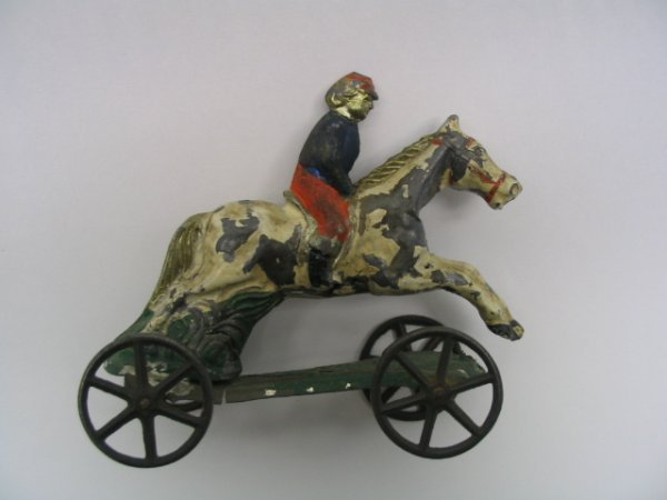 2021: Lead Horse & Rider on Tin Frame Pull Toy