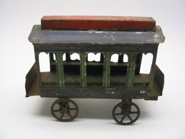2023: Tin Trolley Car Pull Toy