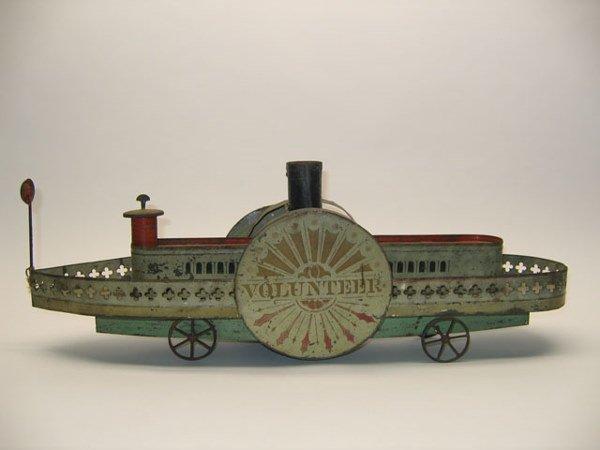 2114: Tin Litho Volunteer Paddle Wheel Toy Boat