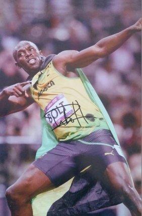 Usian Bolt Signed Photo.