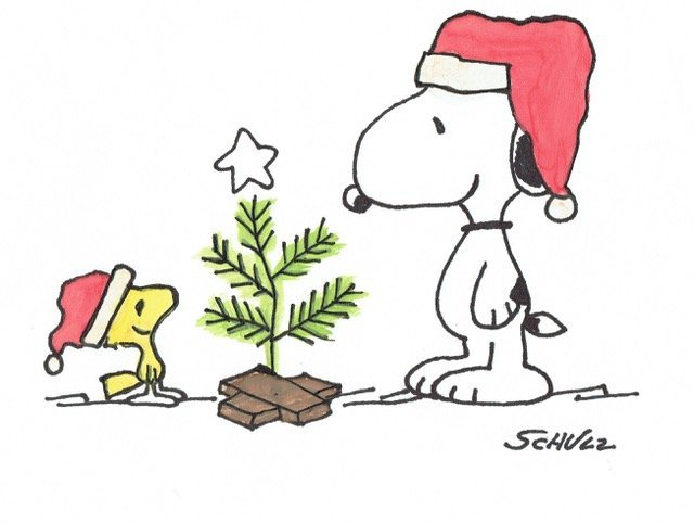 CHARLES SCHULZ: SNOOPY AND WOODSTOCK AT CHRISTMAS.