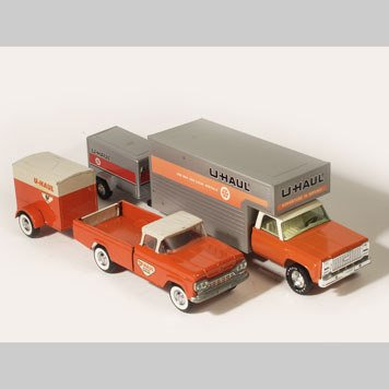 1011- TOY MOVING VANS, U-HAUL TRUCKS AND TRAILERS