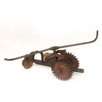103: Antique Self-Propelled Lawn Sprinkler