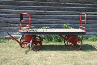 1017: BAGGAGE CART  Flatbed railroad baggage cart with