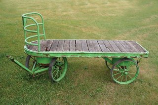 1018: BAGGAGE CART  Flatbed railroad baggage cart with