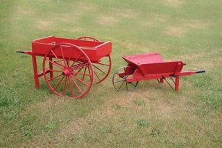 1021: WHEELBARROW AND FLOWER CART  Lot includes a woode