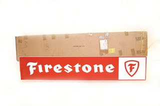 2160: FIRESTONE SIGN  NOS tin Firestone wall sign in it