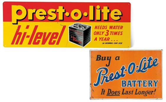 Two Prest-O-Lite Signs