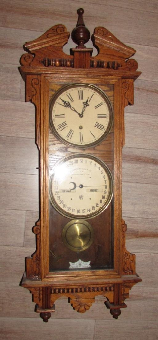 ANTIQUE OAK WATERBURY CALENDAR CLOCK