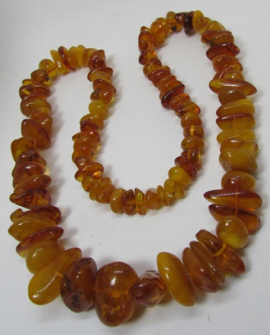 "GRADUATED AMBER BEAD NECKLACE 27"" STRAND 88 GRAMS"