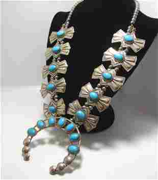 SIGNED TURQUOISE STERLING RIBBON SQUASH BLOSSOM