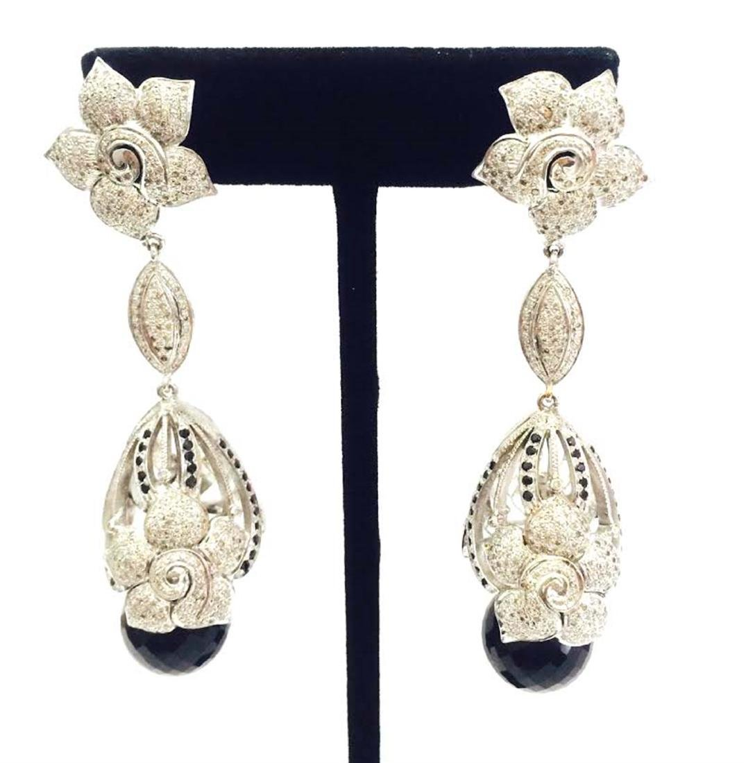 Earring Gold weight 4.15 gram and silver weight 35.57