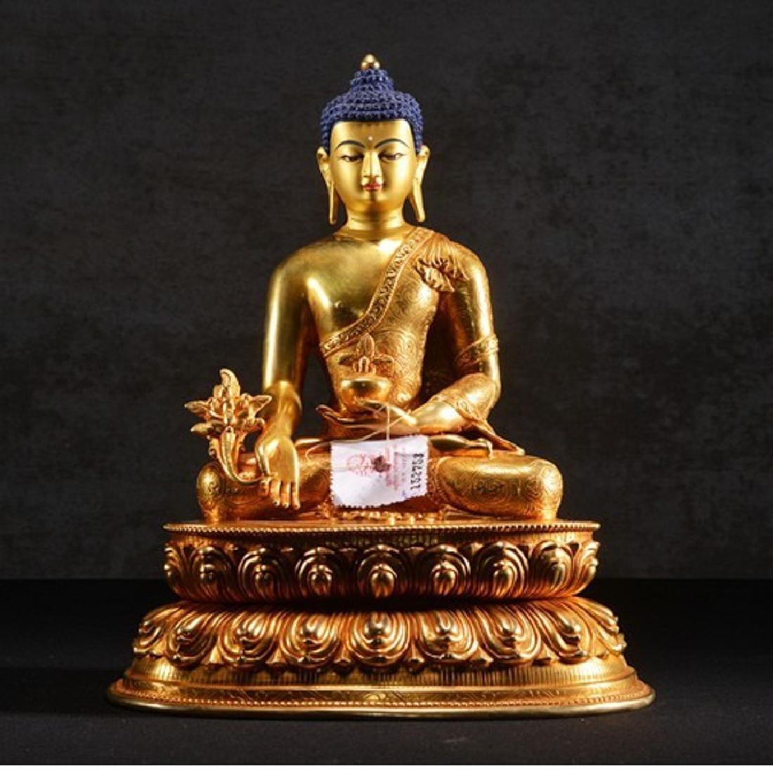 THE GILT BRONZE OF BUDDHA