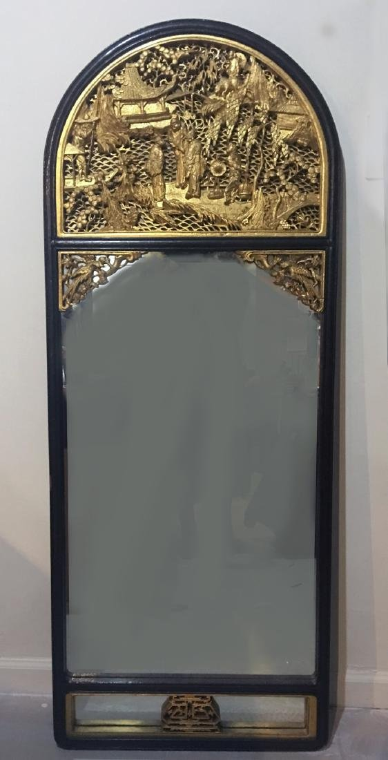 AN ANTIQUE MIRROR