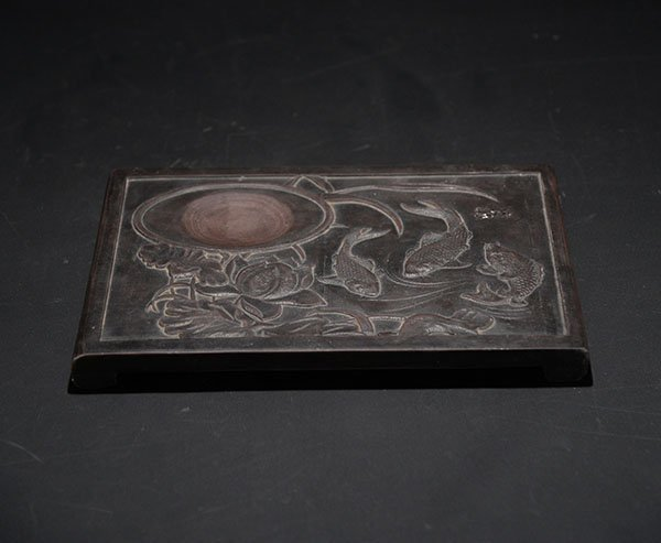 An Inkstone with Flower and Fish Decorations