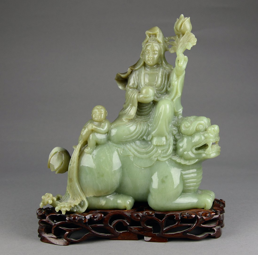 A Yellow Jade of Guan Yin with a Child Ornament