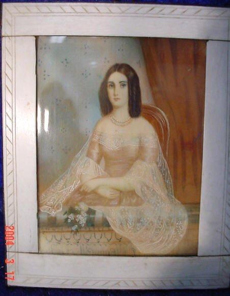 550: Miniature hand painted portrait on ivory