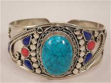 TURQUOISE, RED CORAL, AND CARNELIAN METAL CUFF BRACELET