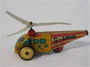 VINTAGE G-AMHK TIN TOY HELICOPTER