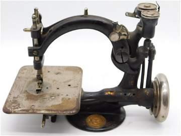 WILCOX & GIBBS ANTIQUE CAST IRON MINI SEWING MACHINE