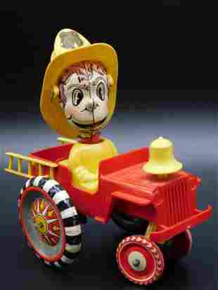 FIREMAN IN FIRE TRUCK TOY TIN LITHO WINDUP VINTAGE