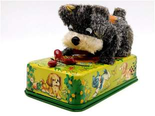 MODERN TOYS PLAYFUL PUPPY WITH CATERPILLAR TOY TIN